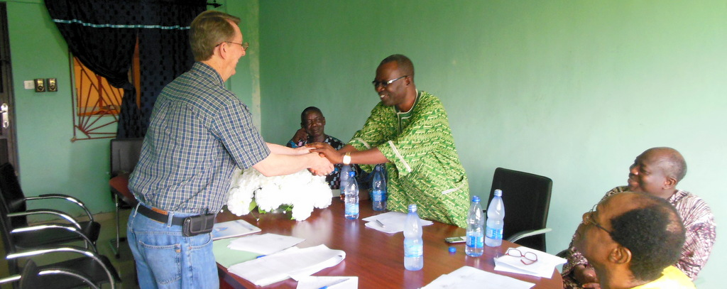 Truitt shaking hands with leaders in Nigeria